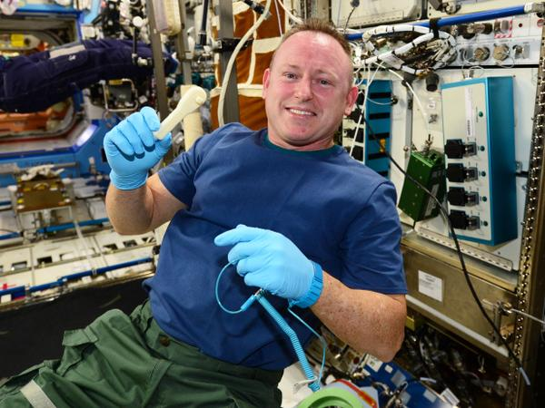 ISS Commander Butch Wilmore holds up the ratchet after removing it from the print tray. Photo courtesy of NASA