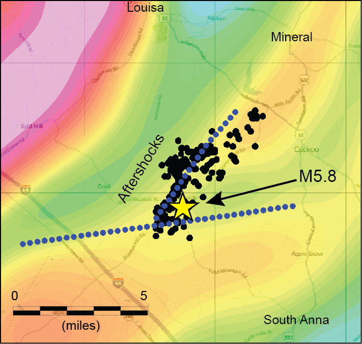 """In map view, magnetic data were filtered (colors) to highlight geologic features near the earthquake depth. One contrast (blue dotted line) is aligned with aftershocks (black dots). The other crosses at an angle. They suggest that the earthquake (yellow star) occurred near a """"crossroads,"""" or a complex intersection of different types of rock."""