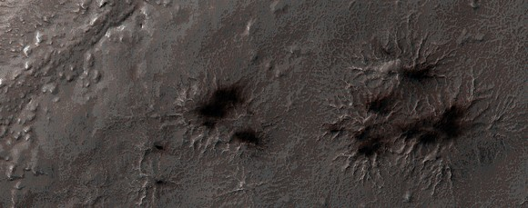 Carbon dioxide ice begins to feel the heat in the south pole region every spring. In this image of 'Inca City' taken in August 2014, you can see a few fans coming out from channels (araneiforms) that are created when pressurized gas escapes from the melting ice. Picture taken Aug. 6, 2014 by the Mars Reconnaissance Orbiter's HiRISE camera. Credit: NASA/JPL/University of Arizona