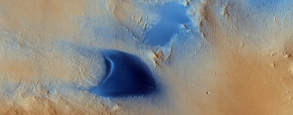 Arabia Terra, one of the dustiest regions on Mars, is filled with dunes such as this one captured by the Mars Reconnaissance Orbiter and released in December 2014. Credit: NASA/JPL/University of Arizona