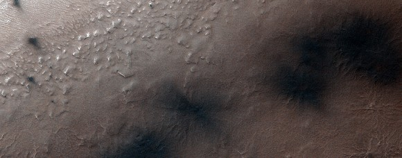 "On Aug. 25, 2014, more fans and blotches appear on the Martian landscape around ""Inca City"", a location in the southern polar region, as the ice bursts in the springtime sun. Image obtained by the Mars Reconnaissance Orbiter's HiRISE camera. Credit: NASA/JPL/University of Arizona"