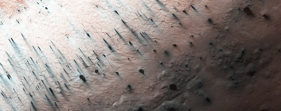 "As spring takes hold in the southern polar region of Mars on Sept. 27, 2014, cracks are now developing in the ice at ""Inca City"" with multiple new dust fans appearing. Cracks develop when the ice does not have a path to easily rupture and release gas. Picture taken by the Mars Reconnaissance Orbiter's HiRISE camera. Credit: NASA/JPL/University of Arizona"