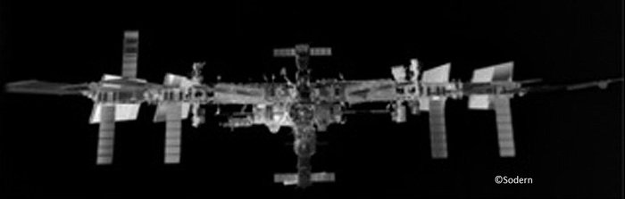 The image above was taken 70 m from the Station – the first showing the complex in this configuration. Ahead of an ATV docking, the Station turns its solar wings to avoid GPS navigation signals bouncing off the structure and confusing the incoming craft. The image was taken by a technology demonstration called Laser Infrared Imaging Sensors, or LIRIS, mounted on ATV Georges Lemaître as it approached the Station for docking on 12 August 2014. Copyright Sodern