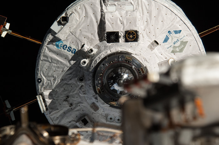ESA's Automated Transfer Vehicle Georges Lemaître seen from the International Space Station as it approaches for docking in August 2014. To the right of the ESA logo, three cameras around the front cone form part of the Laser Infrared Imaging Sensors, or LIRIS, experiment that demonstrated new rendezvous and docking technology. The lidar optical head and its box of electronics sit just above the ESA logo and form the second element of the tracking system. Copyright ESA/NASA/Roscosmos–O. Artemyev