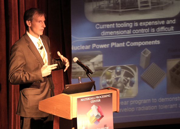 Lockheed Martin Fellow Slade Gardner describes improvements in production, design, and cost in making parts for air and spacecraft during Materials Day Symposium on Oct. 21 at MIT. Photo: Denis Paiste/Materials Processing Center