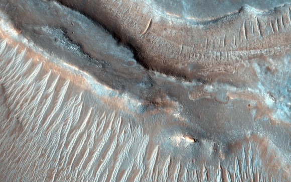 These transverse aeolian ridges seen by the Mars Reconnaissance Orbiter are caused by wind, but scientists are unsure why this image (released in December 2014) shows two wavelengths of ripples. Credit: NASA/JPL-Caltech/University of Arizona
