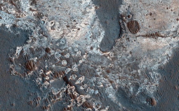 This area south of Coprates Chasma is an example of sulfate and clay deposits on Mars, showing water once flowed readily in this region. Why the water evaporated from the Red Planet is one question scientists are hoping to answer with missions such as the Mars Reconnaissance Orbiter, which took this image (released in December 2014). Credit: NASA/JPL-Caltech/University of Arizona