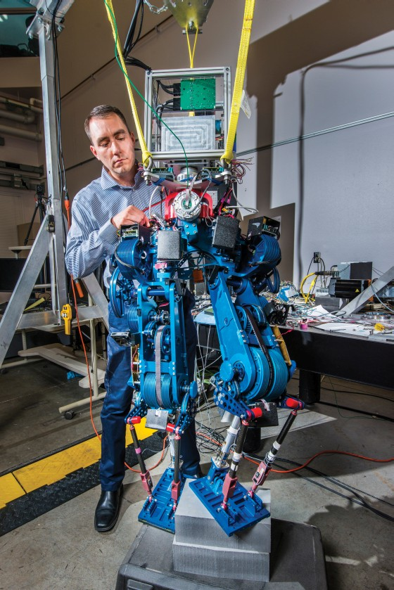 Steve Buerger is leading a Sandia National Laboratories project to demonstrate how energy efficient biped walking robots could become. Increased efficiency could enable bots to operate for much longer periods of time without recharging batteries, an important factor in emergency situations. (Photo by Randy Montoya)