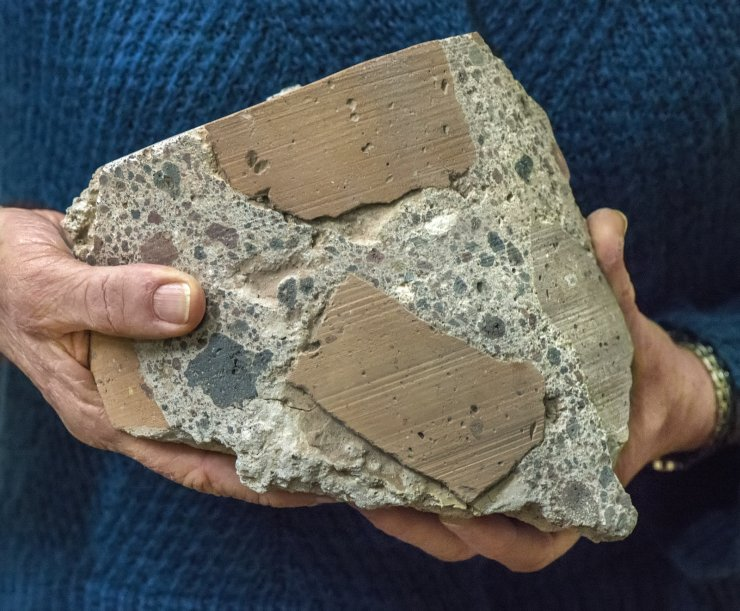 Ancient Roman concrete consists of coarse chunks of volcanic tuff and brick bound together by a volcanic ash-lime mortar that resists microcracking, a key to its longevity and endurance. (Photo by Roy Kaltschmidt, Berkeley Lab)