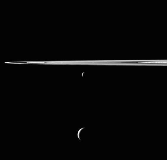 Enceladus and Tethys hang below Saturn's rings in this image from the Cassini spacecraft. Credit: NASA/JPL-Caltech/SS