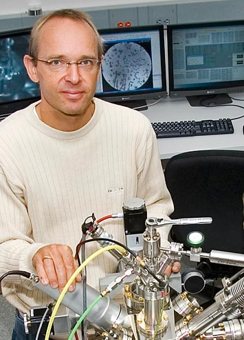 Peter Sutter with one of the low-energy electron microscopes at Brookhaven Lab's Center for Functional Nanomaterials.