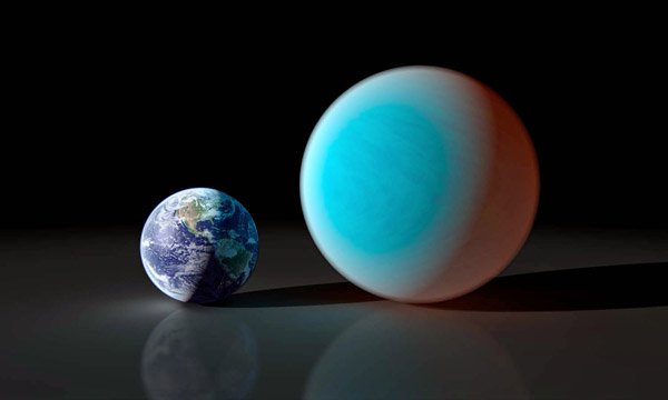 This artist's conception shows the super-Earth 55 Cancri e (right) compared to the Earth (left). Astronomers using a ground-based telescope have measure the transit of 55 Cancri e for the first time. It is the shallowest transit ever detected from the ground. Image credit: NASA/JPL