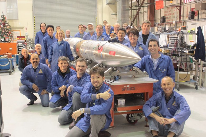 The FOXSI team poses with the rocket, which is scheduled to launch in early December 2014. FOXSI will look for signatures of small solar flares, called nanoflares, on the sun during its 15-minute flight. Image Credit: NASA/FOXSI