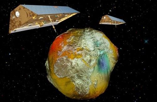Twin-satellites GRACE with the earth's gravity field (vertically enhanced) calculated from CHAMP data. Credit: GFZ