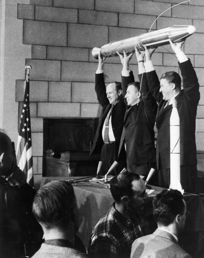 Jet Propulsion Laboratory Director William Pickering (left), Dr. James Van Allen (middle), and Dr. Wernher von Braun (right) hold up a model of Explorer 1, which successfully launched on January 31, 1958. Image Credit: NASA