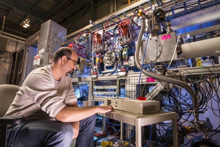Lionel Prost of the Accelerator Division inspects the PXIE low-energy beam transport, which is now capable of delivering 10 milliamps of current. Photo: Reidar Hahn