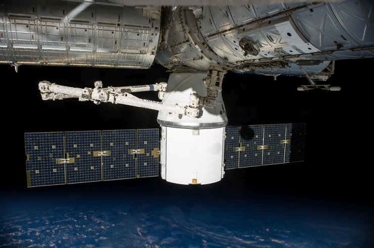 Pictured is SpaceX's uncrewed Dragon cargo spacecraft docked to the International Space Station with a load of supplies and equipment for the station crew. Image Credit: NASA
