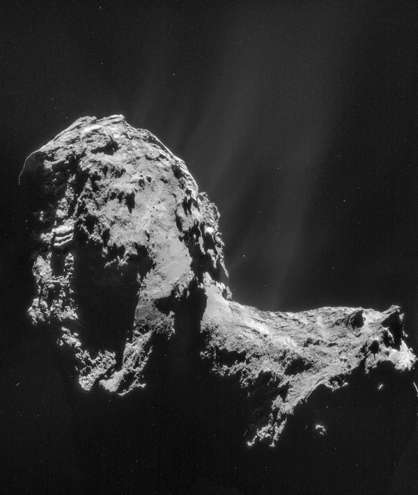 This composite is a mosaic comprising four individual NAVCAM images taken from 19 miles (31 kilometers) from the center of comet 67P/Churyumov-Gerasimenko on Nov. 20, 2014. The image resolution is 10 feet (3 meters) per pixel. Image Credit: ESA/Rosetta/NAVCAM
