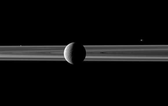 Rhea poses with Saturn's rings; Janus and Prometheus are off in the distance. Credit: NASA/JPL/Space Science Institute.