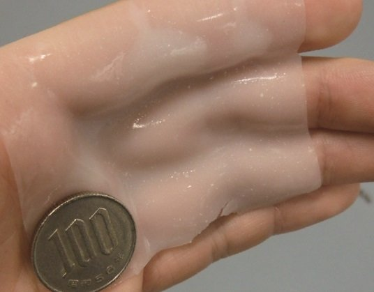 Adhesive gel with superior biocompatibility that can be formed into patterns with light. This novel type of gel can fit to the shape of the fingers when applied to the hand. The gel surface has strong adhesion, and a 100 yen coin does not fall off even when shaken. © 2015 Takao Someya.