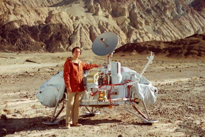 In 1976, two Viking spacecraft landed on Mars. The image is of a model of the Viking lander, along with astronomer and pioneering astrobiologist Carl Sagan. Each lander was equipped with life detection experiments designed to detect life based on its metabolic activities. These activities were assumed to be chemically similar to those of Earthly organisms. The three experiments included: 1) The labeled release experiment, in which radioactively labeled organic nutrients were added to Martian soil. If organisms were present, it was assumed that their metabolism would involve breaking down the nutrients for their energy content and releasing labeled carbon dioxide as a waste product. 2) The gas exchange experiment, in which Martian soil was provided with nutrients and light and monitored for the release of oxygen. On Earth, organisms that capture the energy of sunlight through the process of photosynthesis, like plants and some bacteria, release oxygen as a waste product. 3) The pyrolytic release experiment, in which Martian soil was placed in a chamber with radioactively labeled carbon dioxide. If there were organisms in the soil that photosynthesized like those on Earth, their metabolic processes would take up the gas and use the energy of sunlight to manufacture more complex organic molecules. Radioactive carbon would be given off when those more complex molecules were broken down by heating the sample. All three experiments produced what seemed like positive results. However, most scientists rejected this interpretation because the details of many of the results could be explained by supposing that there were chemical oxidizing agents in the soil instead of life, and because Viking failed to detect organic materials in Martian soil. This interpretation, especially for the labeled release experiment, remains controversial to this day and may need to be revisited based on recent findings. Credits: NASA/Jet Propulsion Laboratory, Caltech