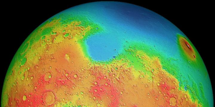 """Mars has two differently shaped hemispheres: the lowlands of the northern hemisphere and the volcanic highlands (yellow to red regions) of the southern hemisphere. A """"giant impact"""" on the southern pole is suspected to be the reason for this. Image credit: MOLA Science Team"""