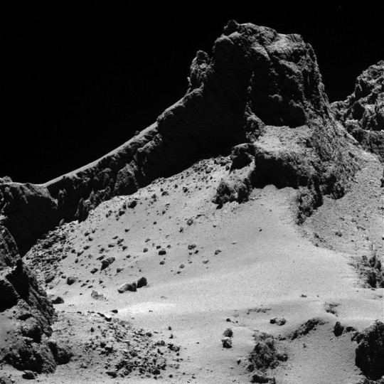 A section of the smaller of Comet 67P/Churyumov–Gerasimenko's two lobes as seen through Rosetta's narrow-angle camera from a distance of about 8 km to the surface on 14 October 2014. The resolution is 15 cm/pixel. The image is featured on the cover of 23 January 2014 issue of the journal Science. Credit: ESA/Rosetta/MPS for OSIRIS Team MPS/UPD/LAM/IAA/SSO/INTA/UPM/DASP/IDA