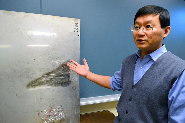 Huang developed a metamaterial that refracts acoustic and elastic waves creating possible applications in super-imaging devices. Credit: Shelby Kardell.