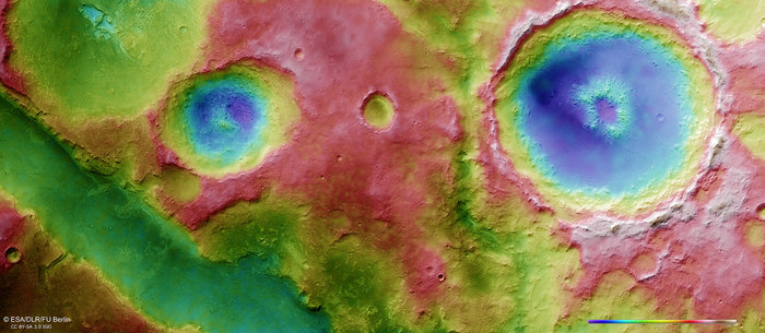 The graben system contains numerous troughs, one of which can be seen crossing the lower left of this image. On the plateau above, several depressions can be seen, some of them extending into the trough. A large, 55 km-diameter impact crater with a central pit can be seen on the right. This colour-coded topographic view is based on a digital terrain model of the region, from which the topography of the landscape can be derived. White and red show the highest terrains, while blue and purple show the deepest. Copyright ESA/DLR/FU Berlin, CC BY-SA 3.0 IGO