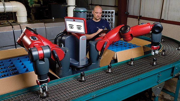 """Baxter, introduced in 2012 by the company Rethink Robotics, is a two-armed robot with a tablet-like panel for its """"eyes."""" Photo: Rethink Robotics, Inc."""
