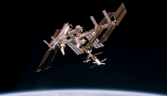 From a Soyuz capsule, Space Shuttle Endeavour, during Expedition 27, is docked to the ISS, 220 miles above the Earth. Before even Apollo 11 landed on the Moon, plans were underway for the next generation spacecraft that would lower the cost of human spaceflight and make trips routine. Forty years have passed since the last Saturn rocket launch and four years since the last Shuttle. Legislators on Capital Hill appear ready to accept a replacement for the Shuttle that, while inherently safer, will cost $600 million per launch excluding the cost of the payload. The Space Launch System (SLS) is destined to serve both human spaceflight and robotic missions. (Photo Credit: NASA)