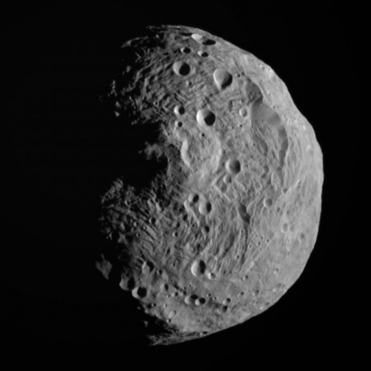 You're looking straight down into the 310-mile-wide (500 km) Rheasilvea crater / impact basin on the asteroid Vesta. It's though that many of the Vesta-like asteroids, including 2004 BL86, originated from the impact. It Credit: NASA/JPL-Caltech/UCLA/MPS/DLR/IDA