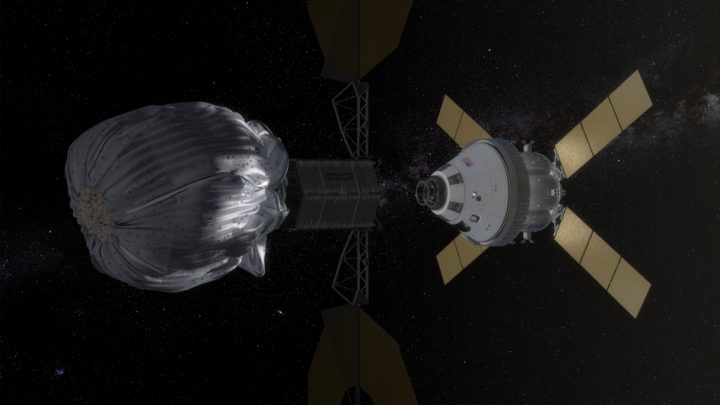An artist's conception of how an unmanned spacecraft might redirect an asteroid into lunar orbit. Credit: NASA