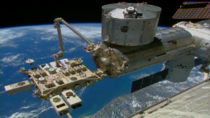 This video frame shows a robotic arm on the space station, called the Japanese Experiment Module Remote Manipulator System, successfully installing NASA's Cloud-Aerosol Transport System (CATS) to the Space Station's Japanese Experiment Module on Jan. 22, 2015. Image Credit: NASA
