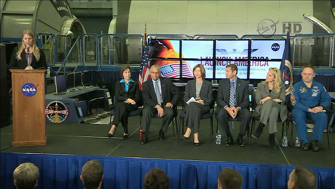 NASA's Stephanie Schierholz introduces the panel of Johnson Space Center Director Dr. Ellen Ochoa, seated, left, NASA Administrator Charles Bolden, Commercial Crew Program Manager Kathy Lueders, Boeing's John Elbon, SpaceX's Gwynne Shotwell and NASA astronaut Mike Fincke. Image Credit: NASA TV