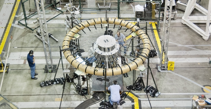 """Technicians prepare the """"donut"""" test article for the Hypersonic Inflatable Aerodynamic Decelerator structural loads testing in NASA Armstrong's Flight Loads Laboratory."""