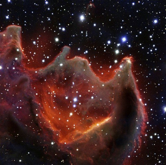 VLT image of the cometary globule CG4. Like the gaping mouth of a gigantic celestial creature, the cometary globule CG4 glows menacingly in this image from ESO's Very Large Telescope. Although it looks huge and bright in this image it is actually a faint nebula and not easy to observe. The exact nature of CG4 remains a mystery. Image credit: ESO