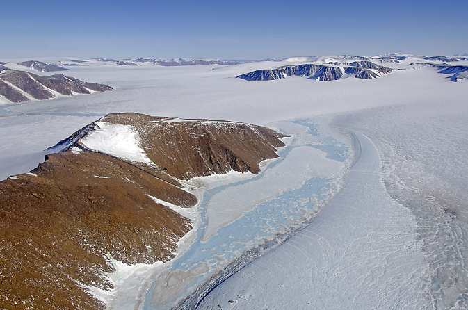 Refrozen meltwater ponds in northeast Greenland seen during an April 2013 IceBridge flight. Image Credit: NASA/Michael Studinger