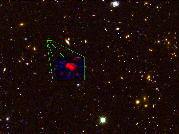 Galaxy z8_GND_5296 (seen in the inset) is the earliest galaxy that astronomers have measured the distance to accurately. It formed approximately 700 million years after the Big Bang, and is forming stars at an incredibly rapid rate. [Credit: V. Tilvi (Texas A&M), S. Finkelstein (UT Austin), the CANDELS team, and HST/NASA]