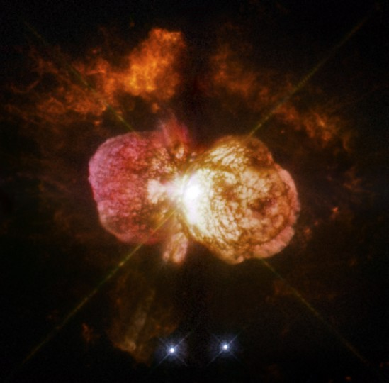 Eta Carinae's great eruption in the 1840s created the billowing Homunculus Nebula, imaged here by Hubble. Now about a light-year long, the expanding cloud contains enough material to make at least 10 copies of our sun. Astronomers cannot yet explain what caused this eruption. Image Credit: NASA, ESA, and the Hubble SM4 ERO Team