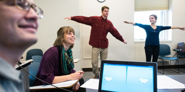 Carmen Petrick Smith, assistant professor of mathematics education (center), works with undergraduate education majors (left to right) Tegan Garon, Sam Scrivani and Kiersten Barr on movements that are used to help elementary school children learn geometry. (Photo: Andy Duback)