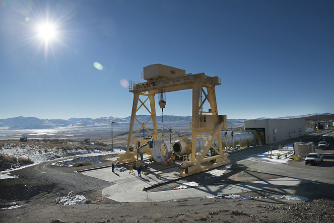 The first qualification motor for NASA's Space Launch System's booster is installed in ATK's test stand in Utah and is ready for a March 11 static-fire test. Image Credit: ATK