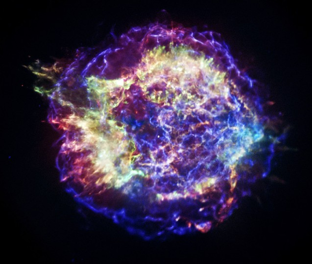 A photograph of Cas A from NASA's Chandra X-ray Observatory reveals the supernova remnant's complex structure. In this representative-color image low-energy X-rays are red, medium-energy ones are green, and the highest-energy X-rays detected by Chandra are colored blue. Image credit: NASA/CXC/SAO