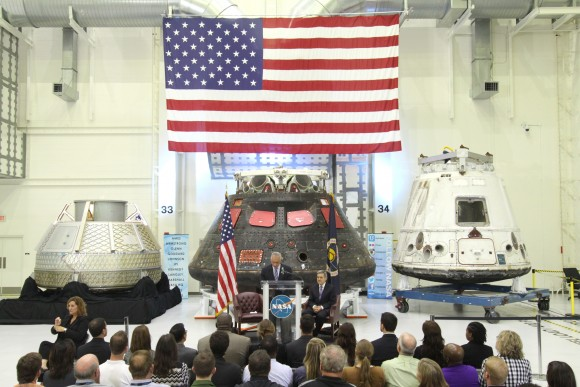 "In the Neil Armstrong Operations and Checkout Building high bay at NASA's Kennedy Space Center in Florida, NASA Administrator Charlie Bolden delivers a ""state of the agency"" address at NASA's televised fiscal year 2016 budget rollout event with Kennedy Space Center Director Bob Cabana looking on, at right. NASA's Orion, SpaceX Dragon and Boeing CST-100 spacecraft were on display. Photo credit: NASA/Gianni Woods"