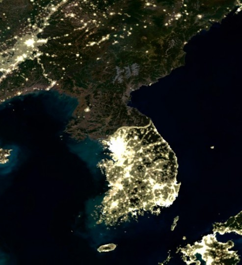 Korean Peninsula at night, satellite image shows a contrast (and border) between North and South Korea, Credit: PlanetObserver/Science Photo Library.