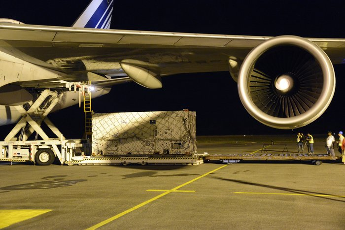 One of two Galileo satellites, safely in its protective container, being unloaded from their Air France Boeing 747 at Cayenne–Félix Eboué Airport in French Guiana on Thursday 5 February 2015. Copyright ESA–Paul Muller