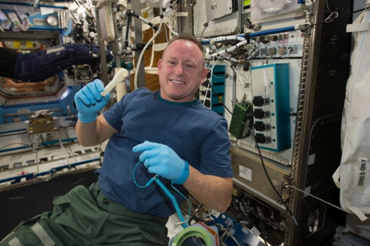 "International Space Station Expedition 42 Commander Barry ""Butch"" Wilmore shows off a ratchet wrench made with a 3-D printer on the station. Image Credit: NASA"