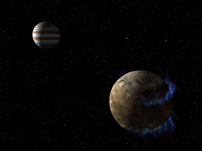 In this artist's concept, the moon Ganymede orbits the giant planet Jupiter. NASA's Hubble Space Telescope observed aurorae on the moon generated by Ganymede's magnetic fields. A saline ocean under the moon's icy crust best explains shifting in the auroral belts measured by Hubble. Image Credit: NASA/ESA