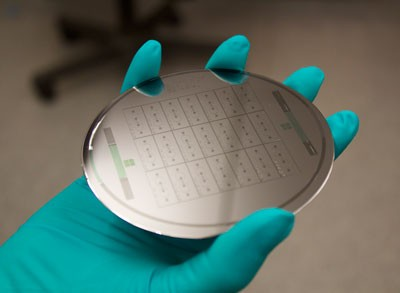 """Wafers like the one shown here are used to create """"organ-on-a-chip"""" devices to model human tissue. Image credit: Anurag Mathur, Healy Lab"""
