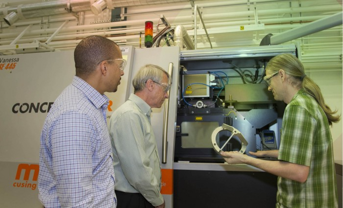 From left : Lawrence Livermore National Laboratory researchers — Ibo Matthews, a principal investigator leading the Lab's effort on the joint open source software project; Wayne King, director of the Accelerated Certification of Additively Manufactured Metals Initiative; and Gabe Guss, engineering associate — examine a 3D-printed part using the selective laser melting process. General Electric and LLNL recently received $540,000 to develop open source algorithms that will improve additive manufacturing of metal parts using SLM. Photos by Julie Russell/LLNL